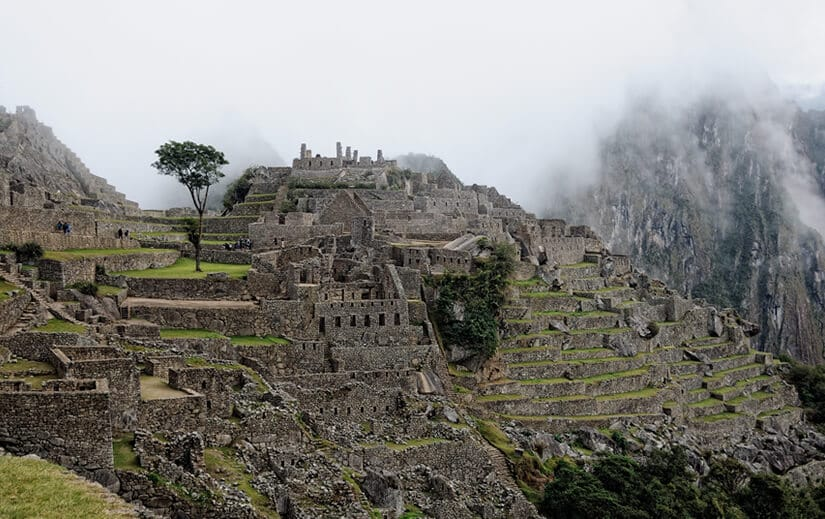 Machu Picchu The dawn mist lifts above the terraced structures