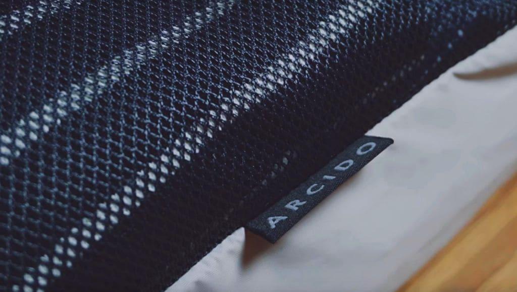 Arcido Akra backpack logo